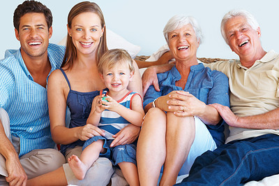 Buy stock photo Portrait of happy family sitting together and smiling