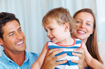 Buy stock photo Mother and father holding their boy and smiling