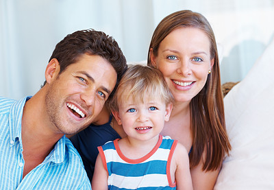 Buy stock photo Closeup portrait of cute family sitting together and smiling