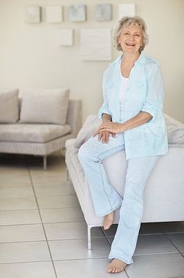 Buy stock photo Portrait of a senior woman relaxing on the sofa at home