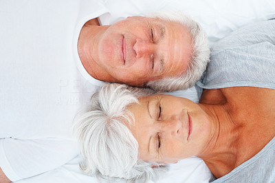 Buy stock photo Closeup of senior couple lying on bed and sleeping