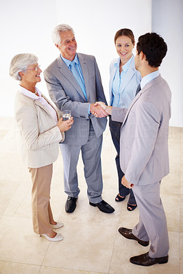 Buy stock photo Portrait of two business men shaking hands in break during a meeting