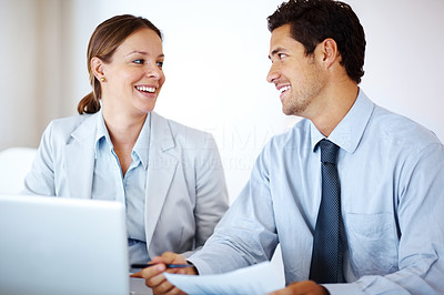 Buy stock photo Portrait of a happy young business colleague working together with  laptop in front at office