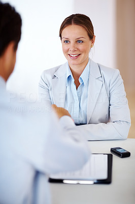Buy stock photo Portrait of a business man sitting at table conducting job interview talking with female applicant