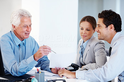 Buy stock photo Portrait of a real estate agent having a discussion with a young couple while signing agreement