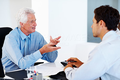 Buy stock photo Financial planner explaining investment scheme to a young business man at office