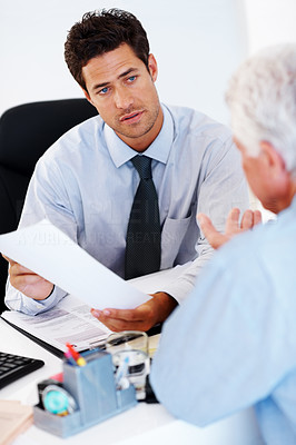 Buy stock photo Young businessman holding a document and discussing  investment scheme with client