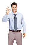 Young businessman giving OK gesture against white