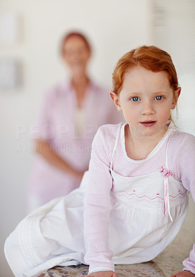 Buy stock photo Portrait of a happy little girl with a mature woman in background