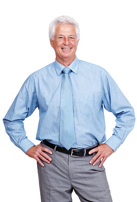 Buy stock photo Portrait of a happy mature business man standing with hands on hips against white background
