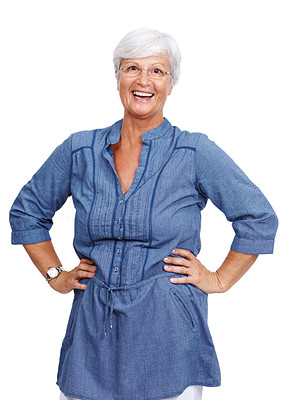 Buy stock photo Portrait of a smiling old woman standing with her arms on hips isolated over white background