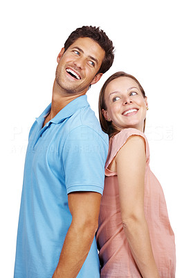 Buy stock photo Portrait of a smiling young couple standing back to back isolated over white background