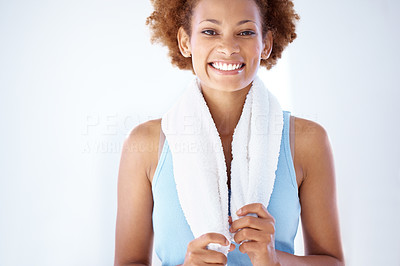 Buy stock photo Portrait of a happy young fitness woman smiling holding towel around her neck