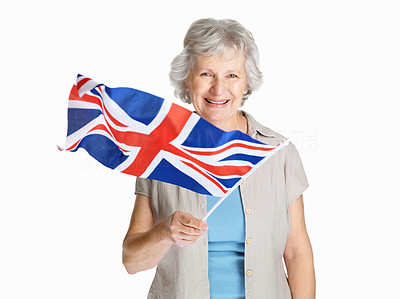 Buy stock photo Portrait of a happy senior female holding a flag of United Kingdom against white