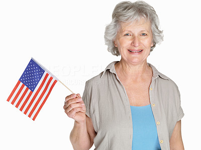 Buy stock photo Portrait of a happy mature woman holding a United States flag against white