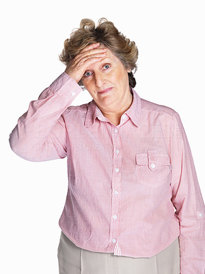 Buy stock photo Portrait of a sad senior woman holding her head in pain isolated against white