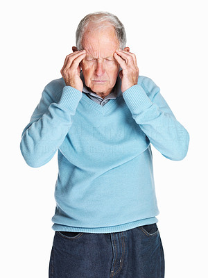 Buy stock photo Portrait of a sad senior man with headache holding his head isolated against white