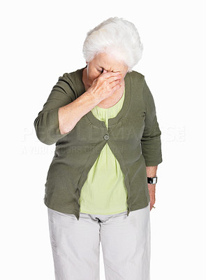 Buy stock photo Portrait of a sad elderly woman holding her head in pain isolated against white