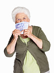 Mature woman smelling paper currency isolated against white