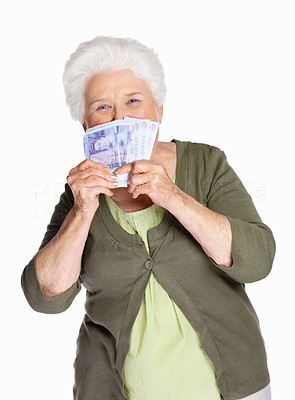Buy stock photo Portrait of a mature woman smelling paper currency isolated against white