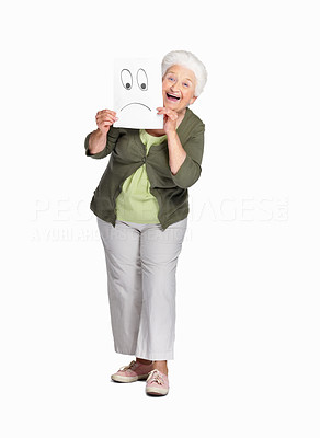 Buy stock photo Full length of a cheerful senior woman holding sheet of sad smiley isolated against white