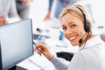 Buy stock photo Happy female telephone operator looking at you and smiling