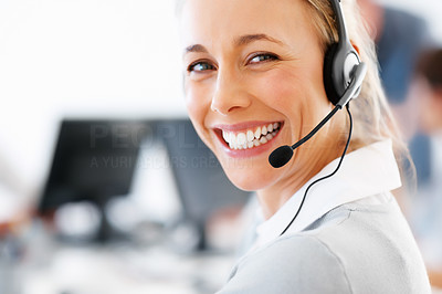 Buy stock photo Closeup of a friendly customer service executive wearing headset and smiling at you - copyspace