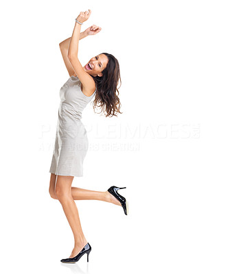 Buy stock photo A joyous young female business executive celebrating success with raised hands on white
