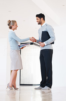Buy stock photo Full length of business man and woman shaking hands after the deal is confirmed