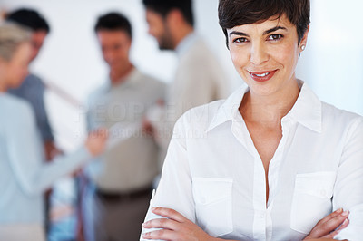 Buy stock photo Portrait of confident business woman with colleagues discussing in background