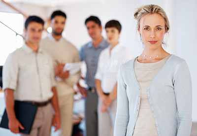 Buy stock photo Confident business woman with supporting team in background