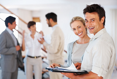 Buy stock photo Happy business man and woman with paperwork and team discussing in background