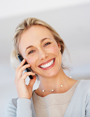 Buy stock photo Closeup of female executive using cellphone and giving you an attractive smile