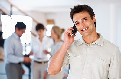 Buy stock photo Portrait of smart business man having conversation on mobile phone and giving you an attractive smile
