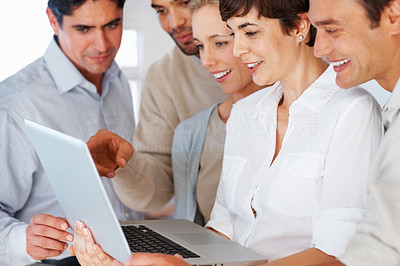Buy stock photo Successful business people reviewing project on laptop
