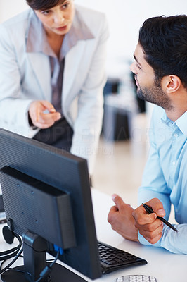 Buy stock photo Executive discussing business matters with colleague