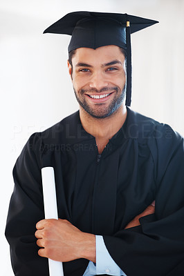 Buy stock photo Portrait of young male graduate holding his degree