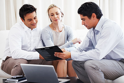 Buy stock photo Couple discussing investment plans with business consultant