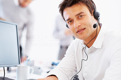 Buy stock photo Portrait of confident business man wearing headset with colleagues in background