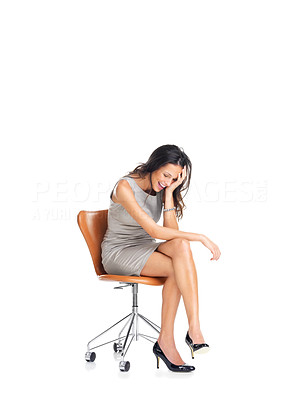 Buy stock photo Cute young lady sitting on a chair and laughing isolated on white background