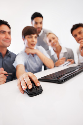 Buy stock photo Business woman with her colleagues using computer mouse during meeting