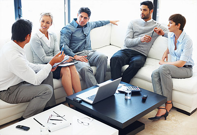 Buy stock photo Male executive sharing his ideas to colleagues during business meeting