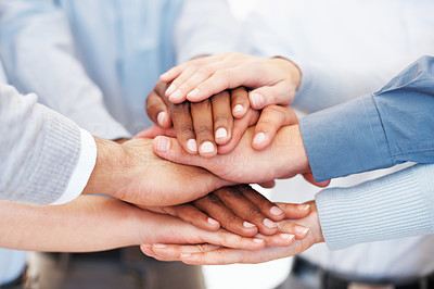 Buy stock photo Closeup of business team putting their hands on top of each other