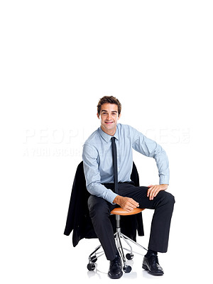 Buy stock photo Relaxed young businessman sitting on a chair and smiling isolated on white background