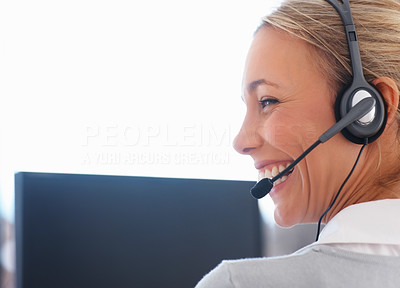 Buy stock photo Closeup of smiling customer care representative in front on computer - copyspace