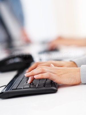 Buy stock photo Cropped image of female executive typing on the computer keyboard