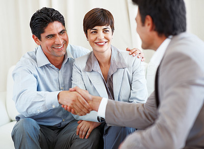 Buy stock photo Business couple with the man shaking hands with consultant