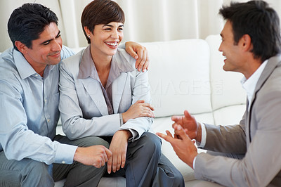 Buy stock photo Business couple discussing with professional financial consultant during meeting