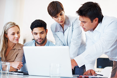 Buy stock photo Business group sitting at table and discussing project on laptop