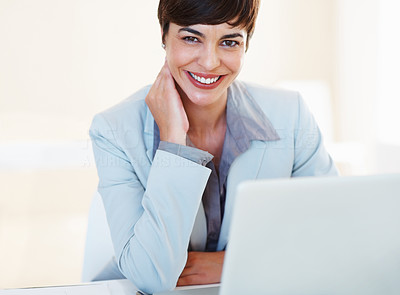 Buy stock photo Portrait of beautiful business woman with laptop sitting at her desk